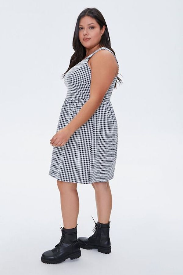 A model wearing a plus-size gingham dress.