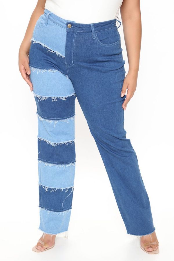 A model wearing a pair of plus-size patchwork jeans.