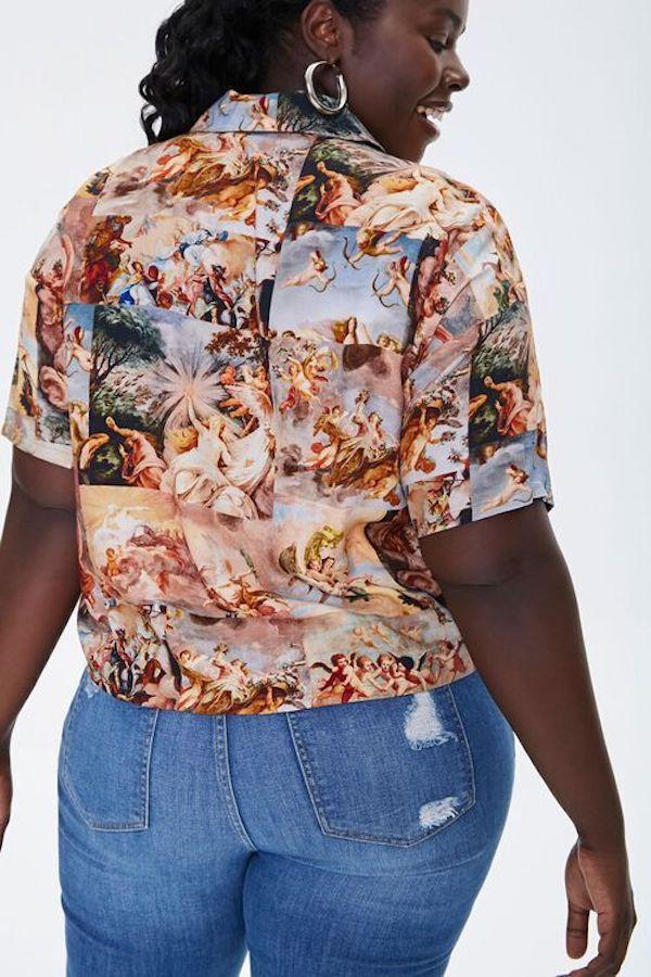 A model wearing a plus-size renaissance top.