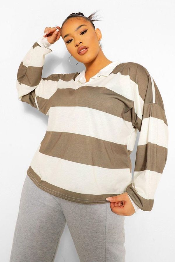 A model wearing a plus-size rugby shirt.