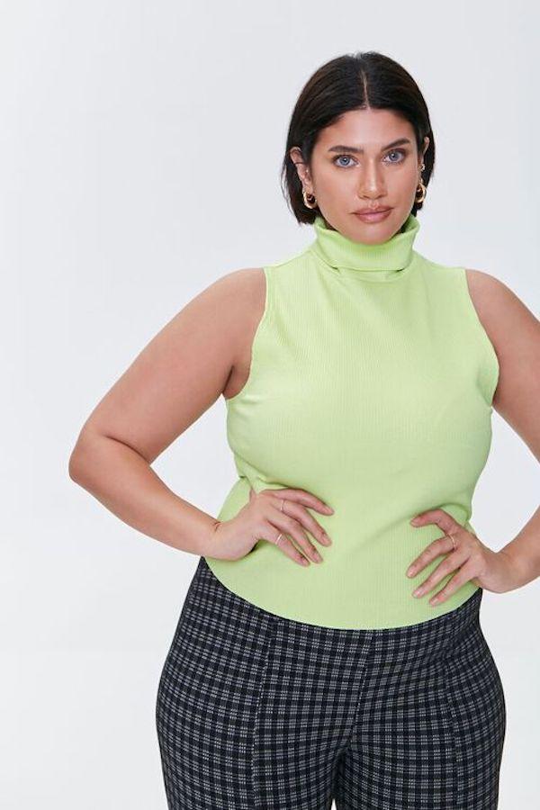 A model wearing a plus-size sleeveless turtleneck.