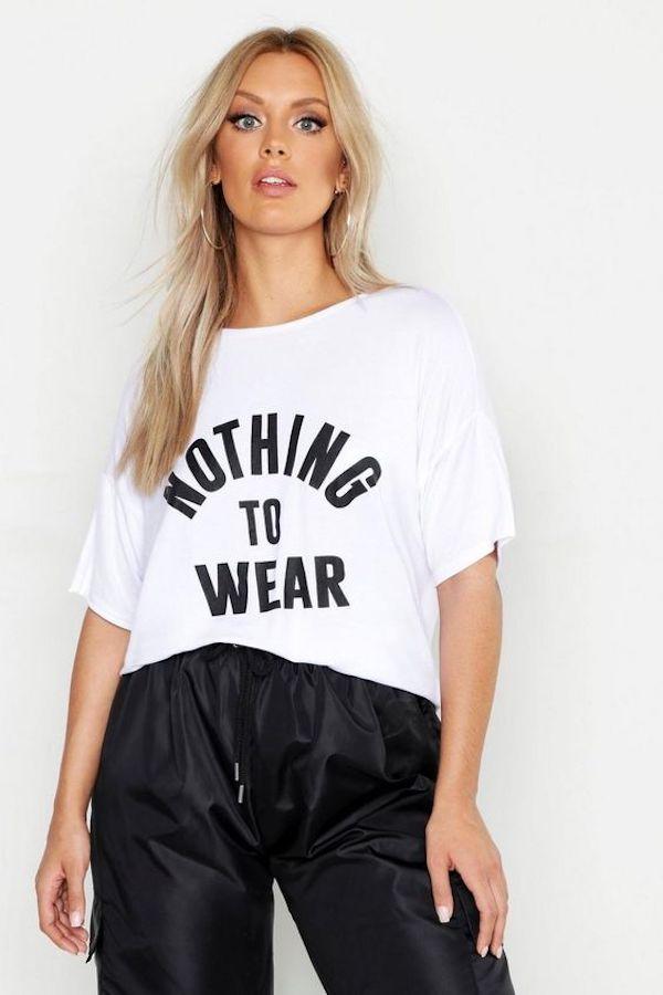 A model wearing a plus-size slogan T-shirt.