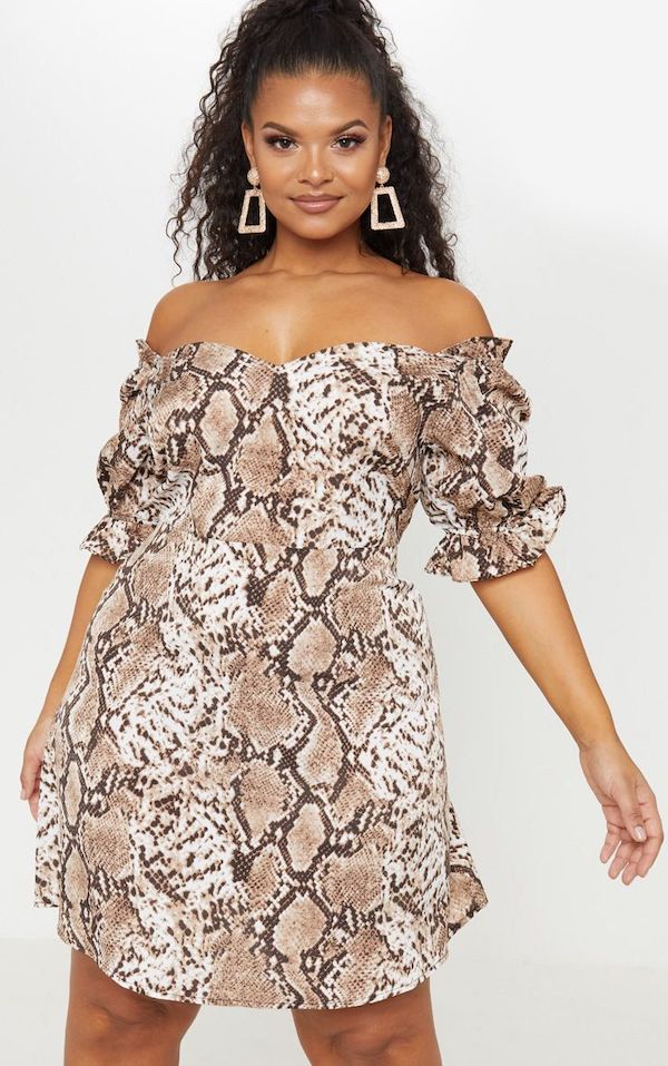 A model wearing a plus-size snake print dress.