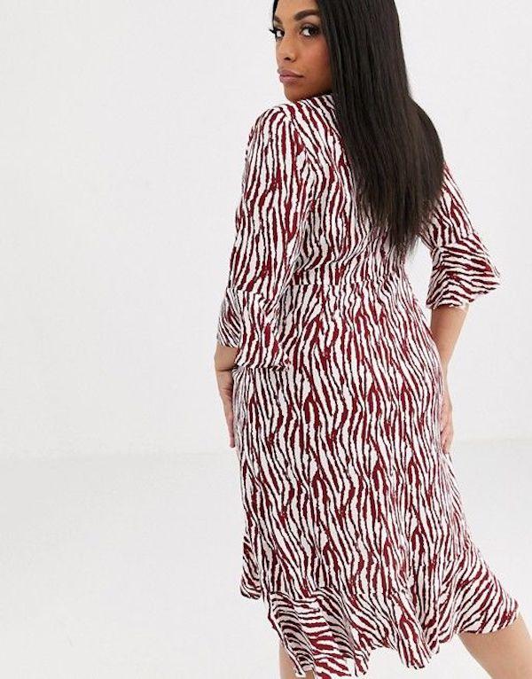A model wearing a plus-size zebra print dress.