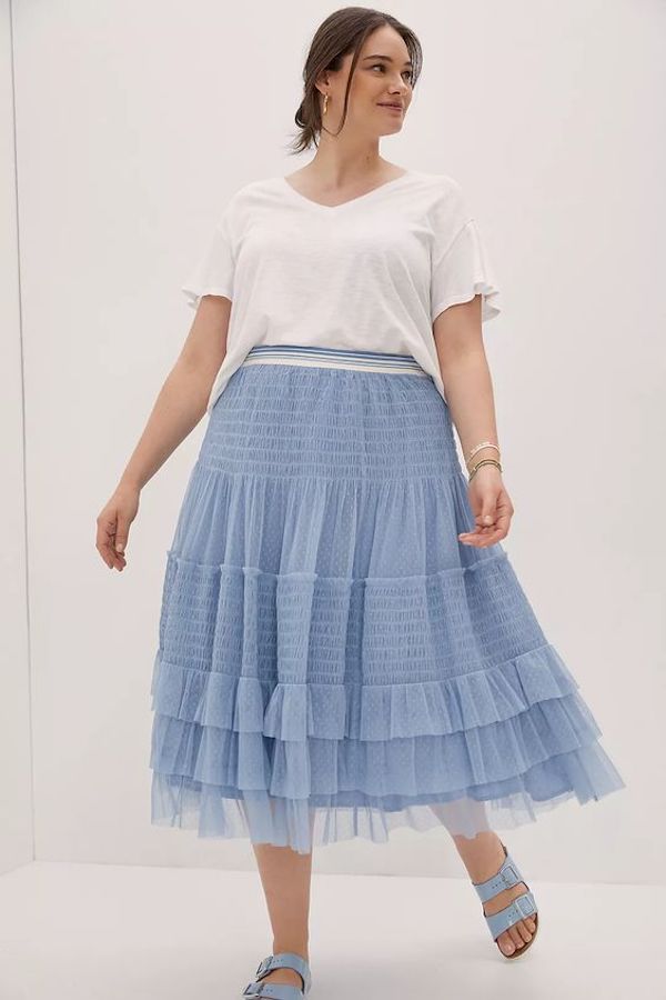 A model wearing a plus-size cottagecore skirt.