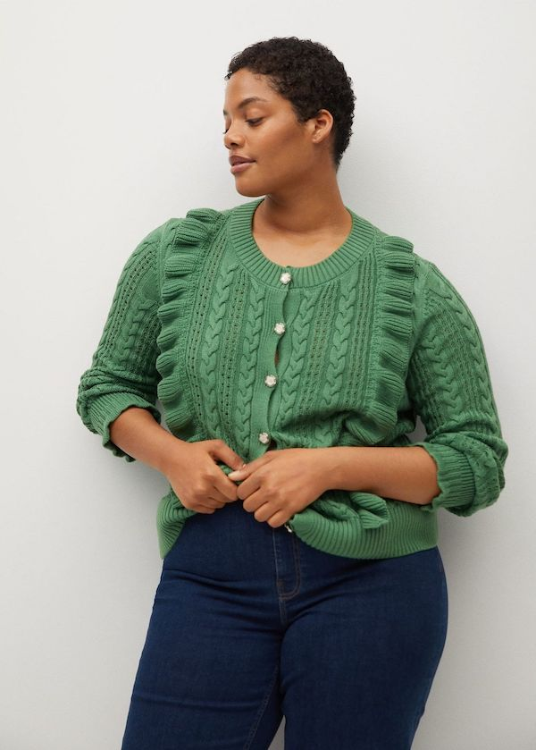 A model wearing a plus-size cottagecore top.