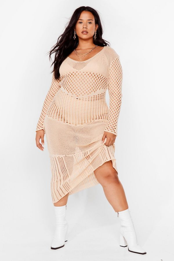 A model wearing a plus-size crochet dress.