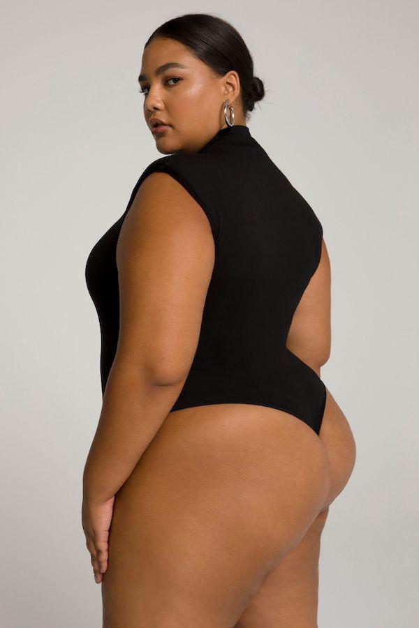 A model wearing a plus-size thong bodysuit.