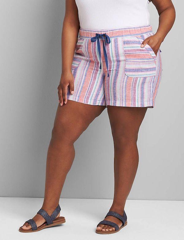 A model wearing plus-size linen shorts.