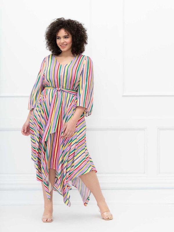 A model wearing a plus-size rainbow dress.