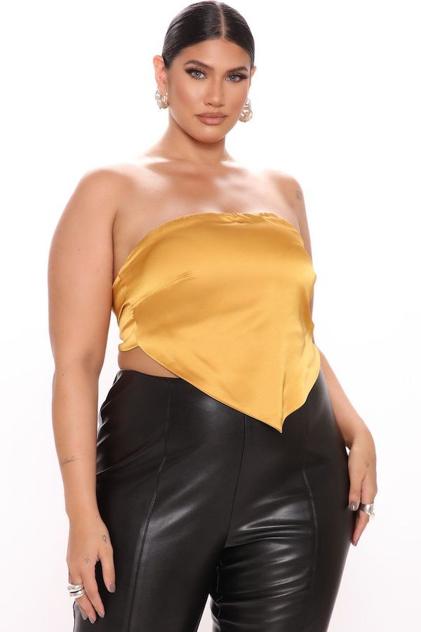A model wearing a plus-size scarf top.