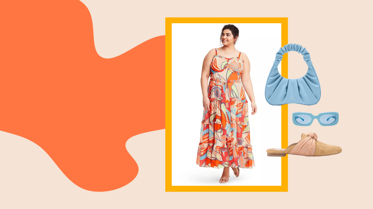 A model wearing a plus-size colorful dress, blue purse, blue sunglasses, and mules.