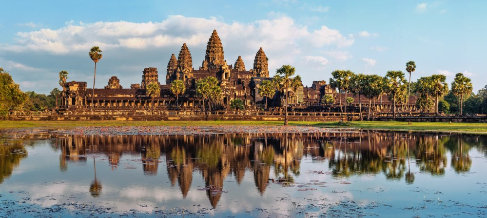 Magnificent Angkor Watt reflecting on the lake. So proud are they of Angkor that it features on the Cambodian flag
