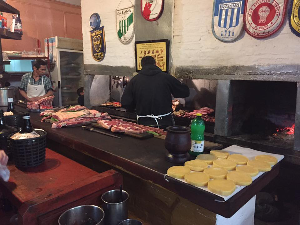 Photo taken in the Parrilla restaurant where you can see the steaks being cooked over charcoal.