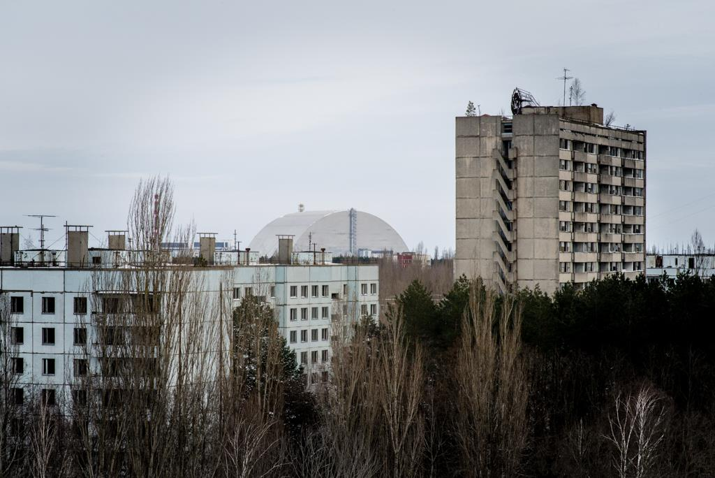 View from the rooftops with the new sarcophagus of Reactor 4 in the not so distant horizon