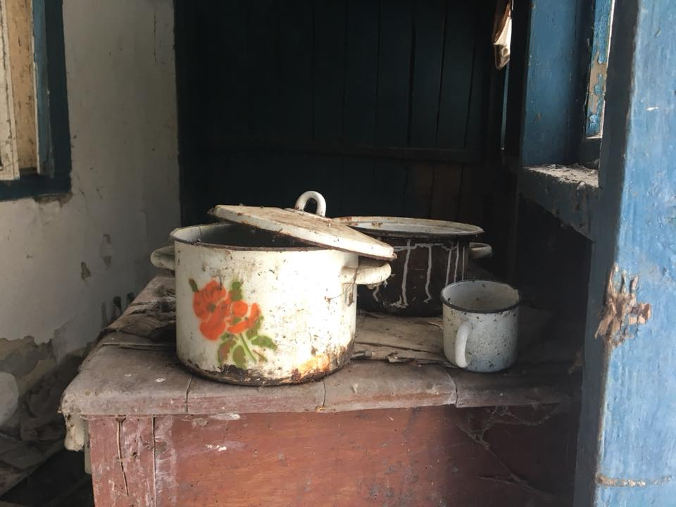 A photo of pots and pans sitting a top of kitchen surface, left behind by the rushing residents as they evacuated their homes.