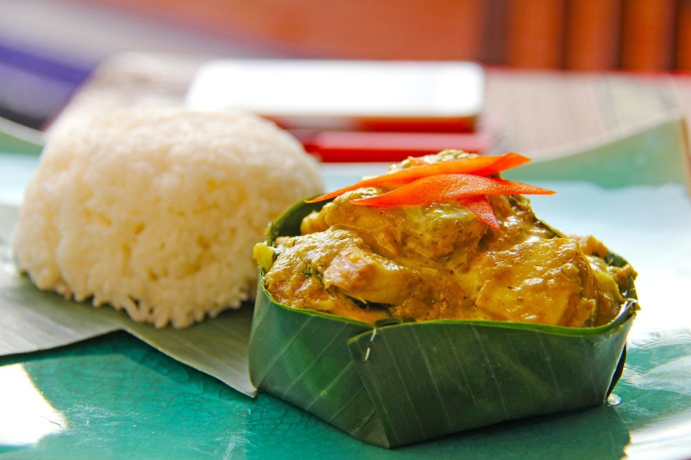 Photo of Fish Amok (which resembles a curry) served in a banana leaf