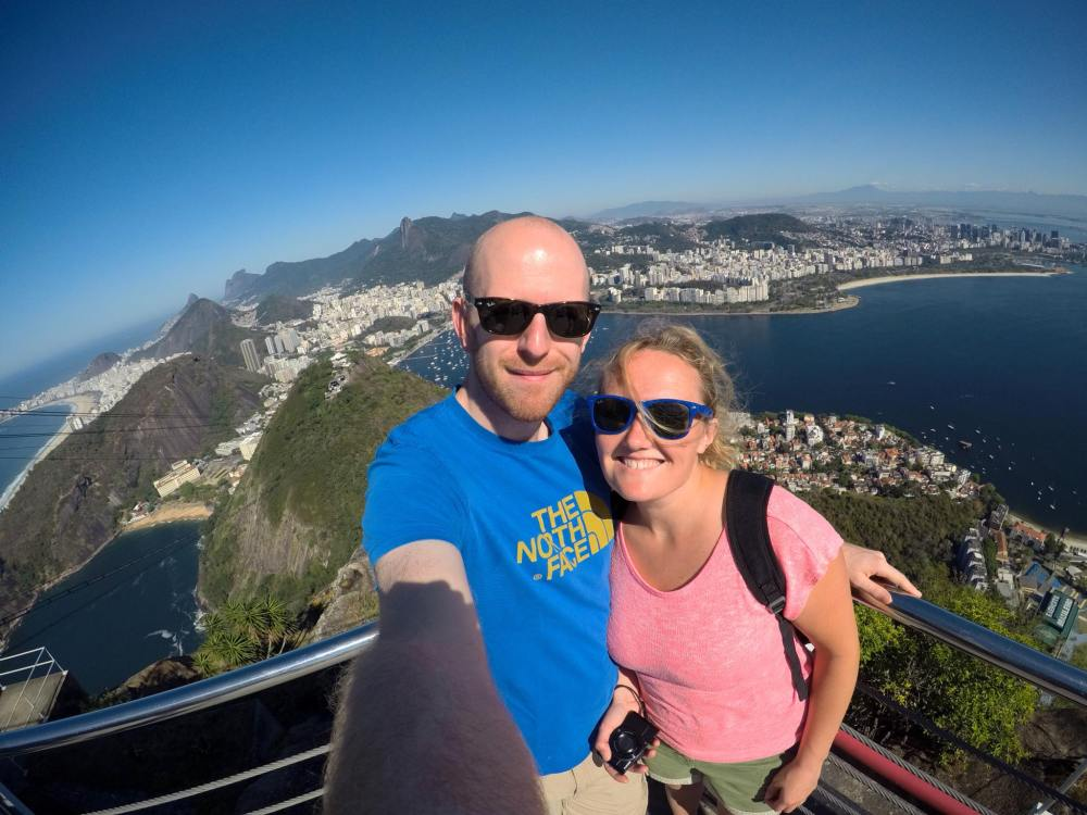 Selfie of Doug and me with the Rio in the background, taken from Sugarloaf Mountain