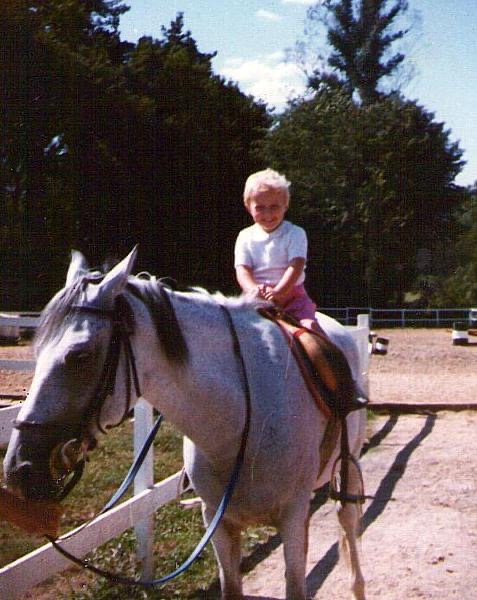 Photo of me as a kid, at a guess 2 or 3 years old, sitting on a grey horse. The picture of happiness.