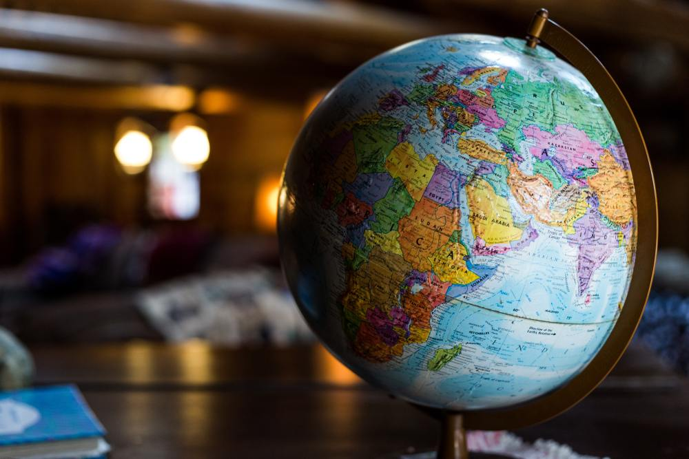 Planning travel is sometimes just a matter of closing your eyes and seeing where on the globe your finger lands!