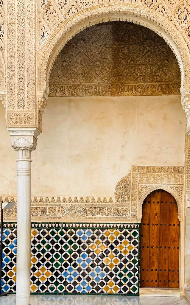 Tiled wall leading up to a door with an arch over it, Alhambra, Granada