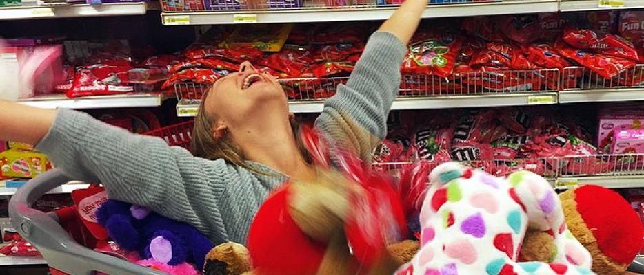 Marina Barnes at Target in a shopping cart full of plush animals
