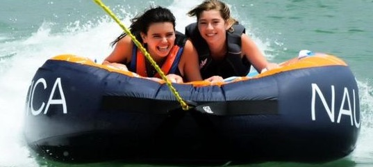 girls tubing at the beach