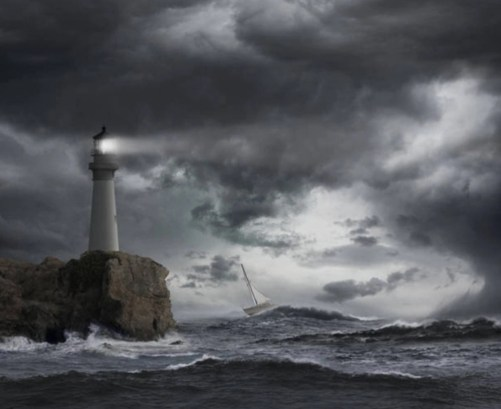 lighthouse guiding ship in storm