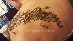 Shoulder henna tattoo