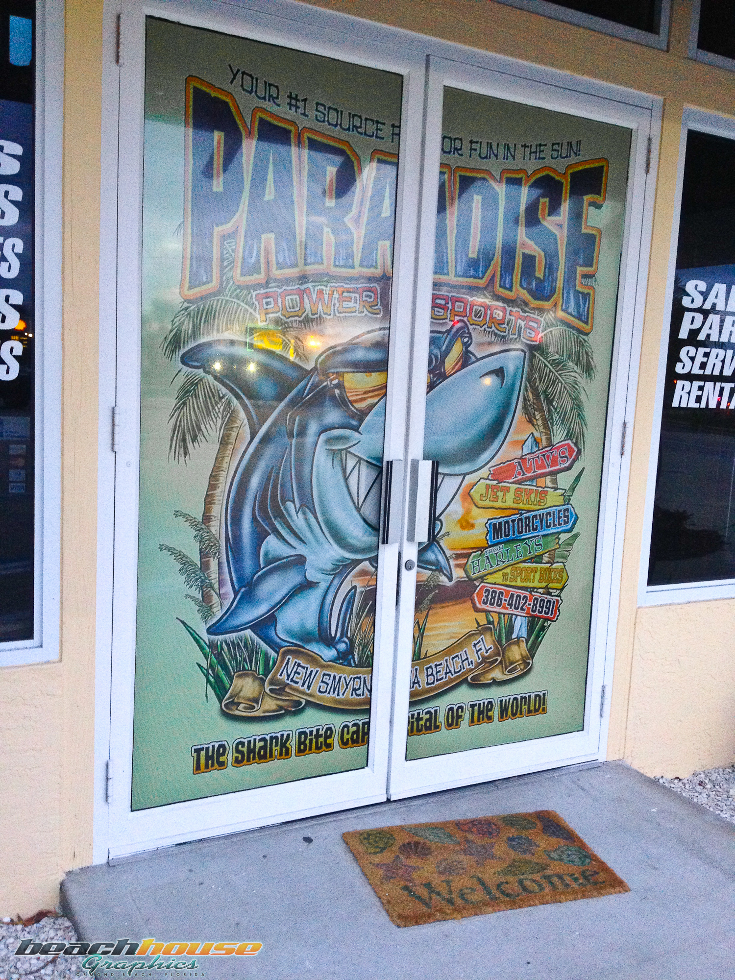 Wall graffiti vinyl lettering - Paradise Power Sports Front Doorway