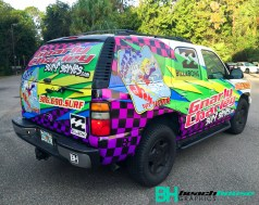 surfer graphics on a Chevy Tahoe by Beach House Graphics