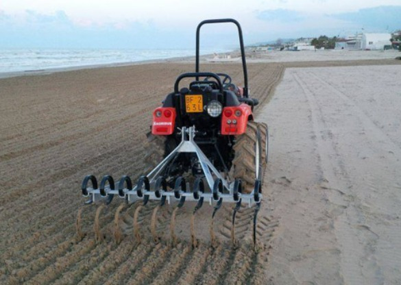 Tractor Ripping Beach Plastic