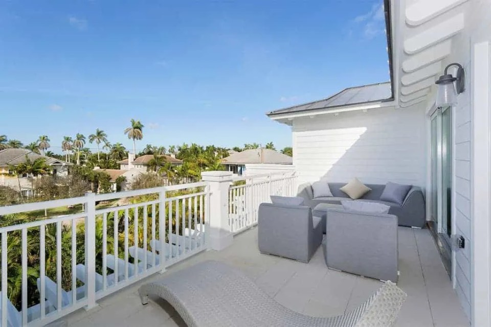 Island Contemporary - Beach House Tour - Beach House Coastal Decor Ideas - Air Bnb in Delray Beach Florida - Upstairs Balcony