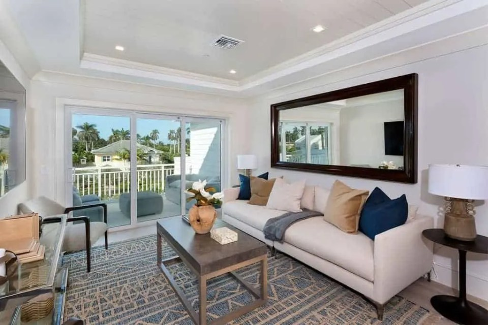 Island Contemporary - Beach House Tour - Beach House Coastal Decor Ideas - Air Bnb in Delray Beach Florida - Den with Balcony