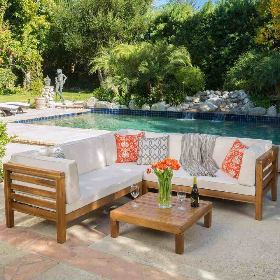 Beach House Outdoor Living Space Ideas - Teak wood sectional with beige cushions