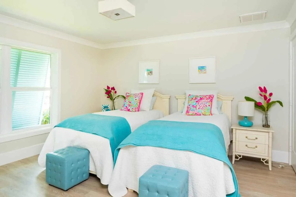 Beach House Bedroom Design Ideas - Twin beds with aqua and pink color scheme