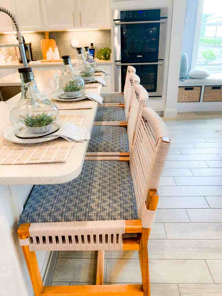 Beach Walk House Tour - Coastal Chic Design and Decor Ideas - Light wood strung bar stools
