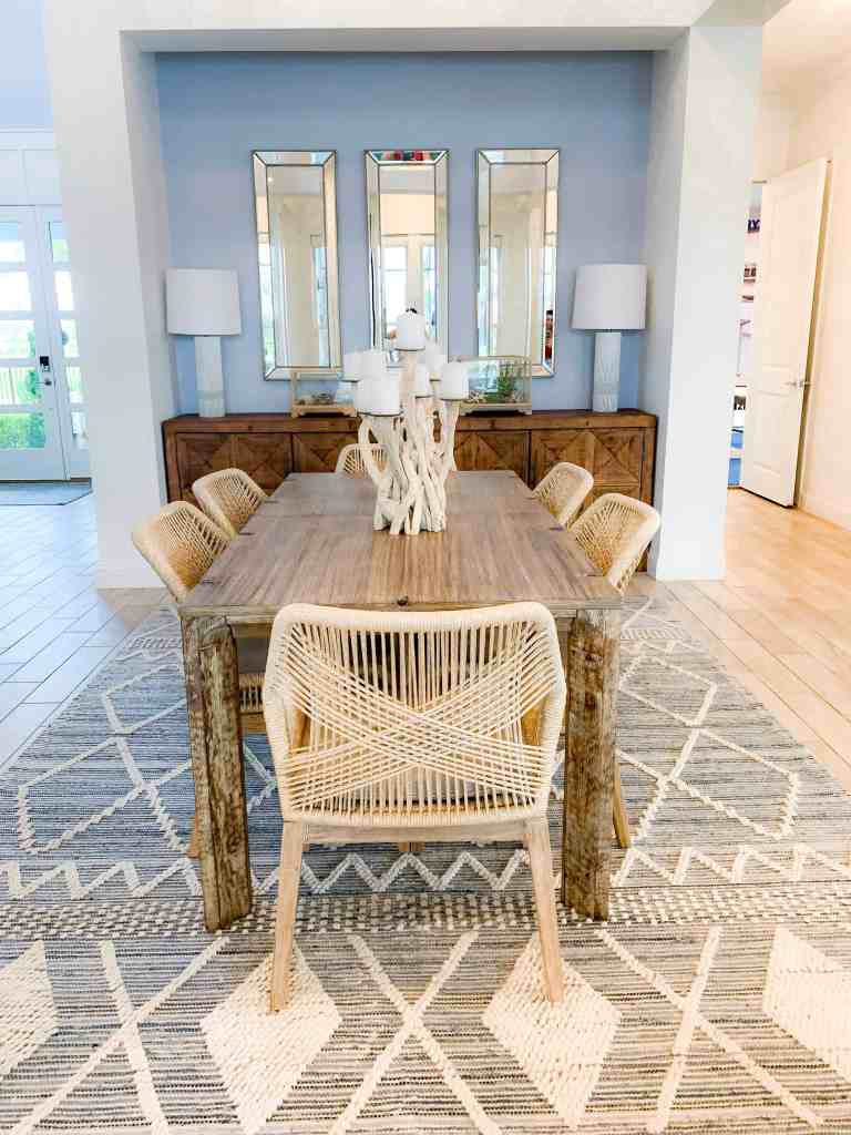 Beach Walk House Tour - Coastal Chic Design and Decor Ideas - Dining area with light wood sideboard