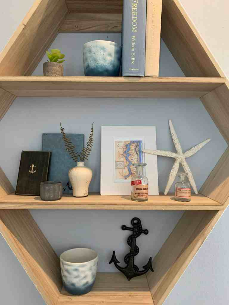 Beach Walk House Tour - Coastal Chic Design and Decor Ideas - mounted wood wall shelf