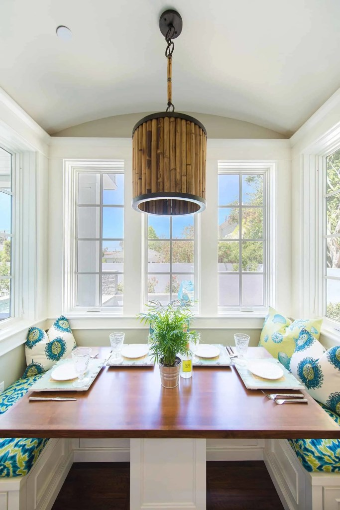 Blue Coastal Dream   Beach House Decor Ideas   Colorful breakfast nook with built in bench seating