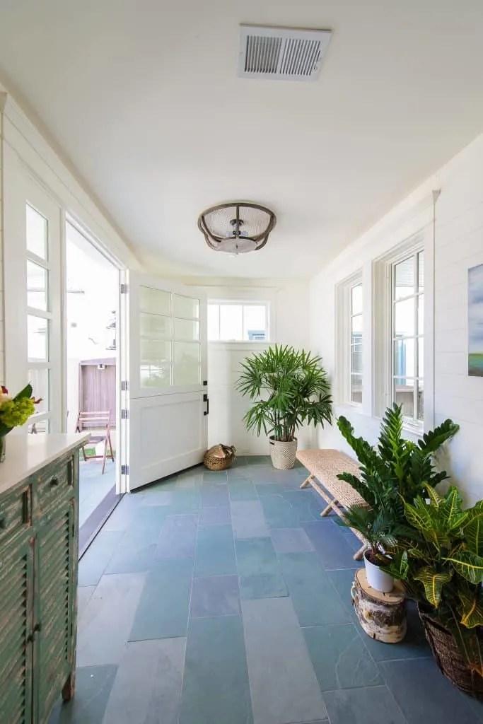 Blue Coastal Dream | Beach House Decor Ideas | Entryway with beige wicker bench