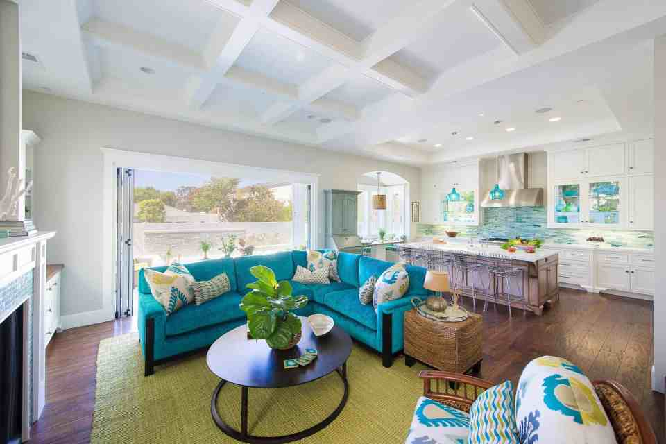 Blue Coastal Dream | Beach House Decor Ideas | Kitchen and living area with blue couch