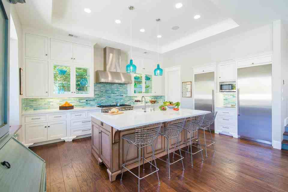 Beach House Kitchen Ideas - Blue Coastal Dream Beach House Kitchen - White Kitchen With Blue Teal Backsplash and Pendant Lights