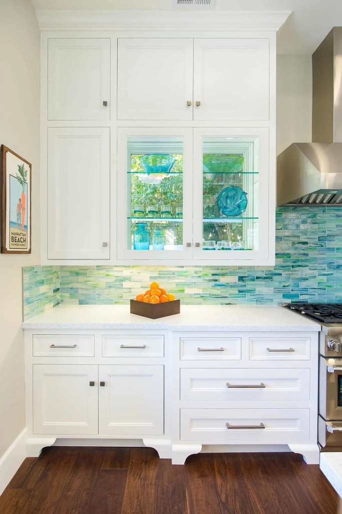 Blue Coastal Dream | Beach House Decor Ideas | Kitchen with white cabinets and glass front cabinets
