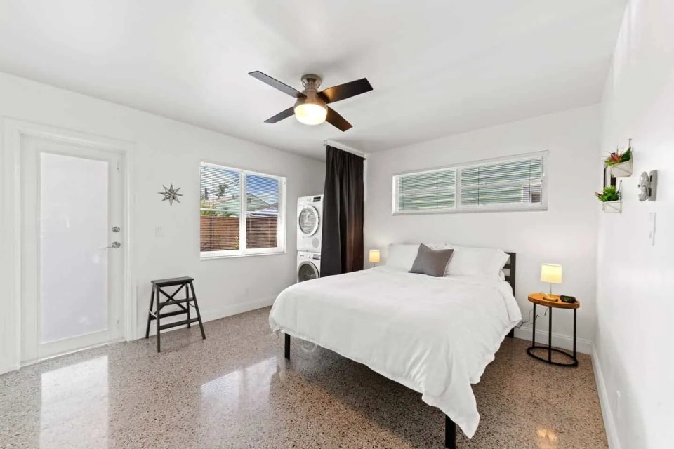Orange Blossom Villa - Lake Worth Beach Airbnb Vacation Rental - Bedroom with white clean linens