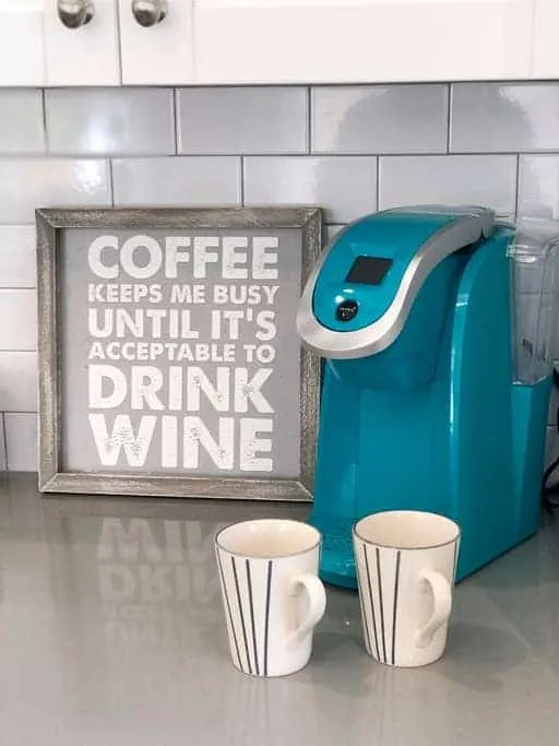 "Bent Palm Jupiter AirBnb Coffee Station With Blue Keurig Machine And Coffee Sign ""Coffee Keeps Me Busy Until It's Acceptable To Drink Wine"""