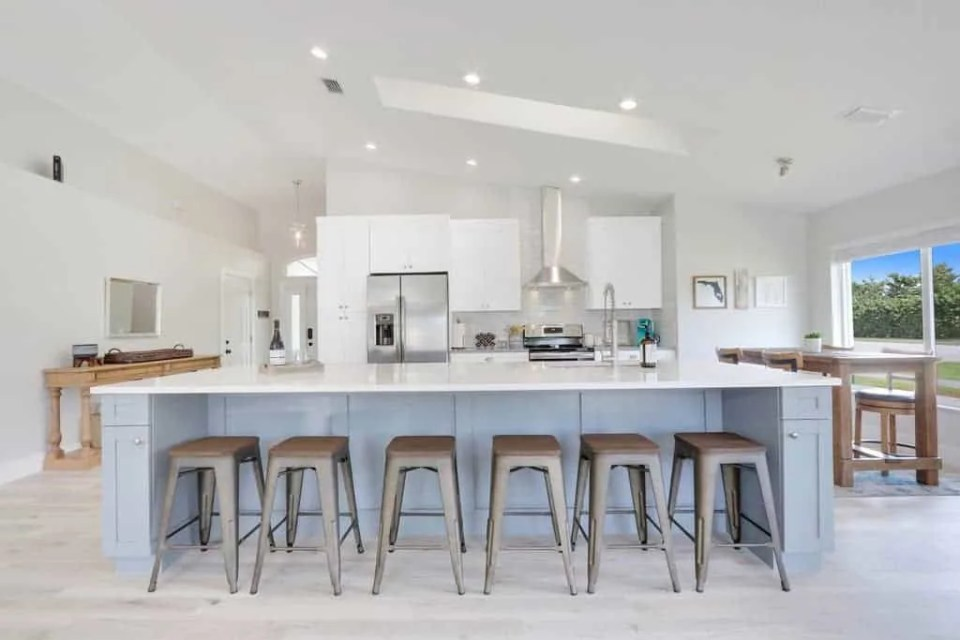 The Bent Palm Jupiter FL AirBnb Open Kitchen with large island and bar stools