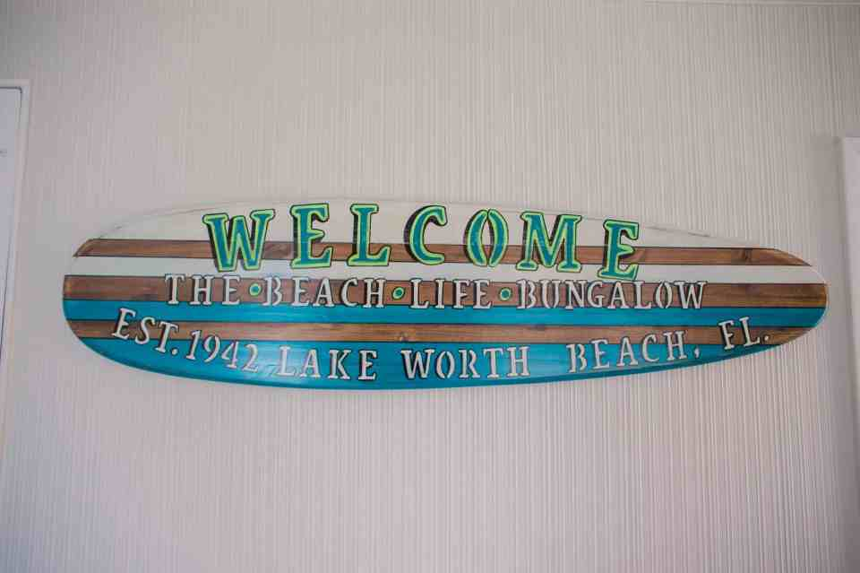 The Beach Life Bungalow - AirBnb in Lake Worth Beach Florida - Custom Surfboard Sign