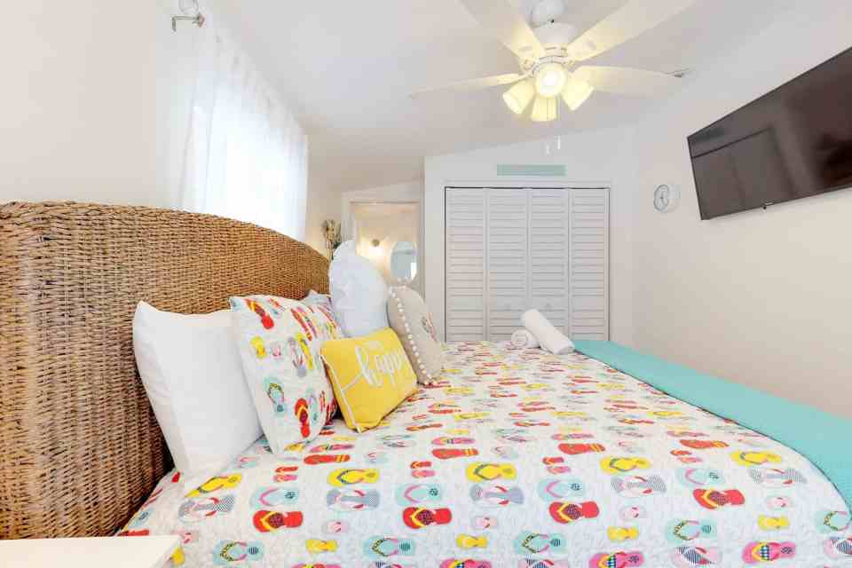 Tranquil Coastal Teal and Yellow Beach House Tour - Bedroom With Flip Flops Bedding