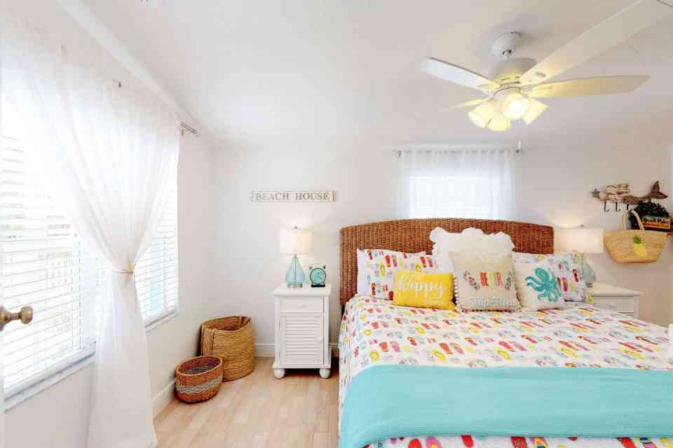 Tranquil Coastal Teal and Yellow Beach House Tour - Flip Flop Room